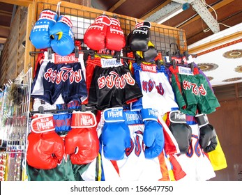 PATTAYA, THAILAND - FEBRUARY 24: Thai boxing pants and Thai boxing gloves, one of the most famous culture of Thailand in present, displayed at the shop on February 24, 2013 in Pattaya, Thailand.