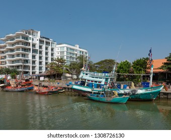 Pattaya, Thailand - February 9, 2019: Luxury condominiums are increasingly displacing the fishermen who 50 years ago used to dominate the beaches in Jomtien and Pattaya in Eastern Thailand.