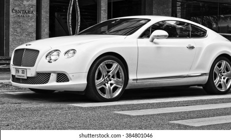 PATTAYA, THAILAND - JANUARY 08, 2016: British luxury car Bentley Continental GT at the city street.Black and white