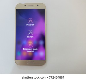 Pattaya, Thailand. January 11, 2018: a close up view of an android smartphone with power off, restart and emergency mode  icon. smartphone isolated on white background and copy space.