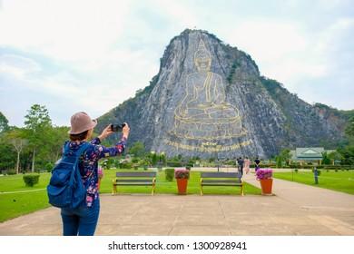 Pattaya, Thailand - January 2019 : Asian woman taking photo of Khao Chee Chan mountain at Pataya, Chonburi.
