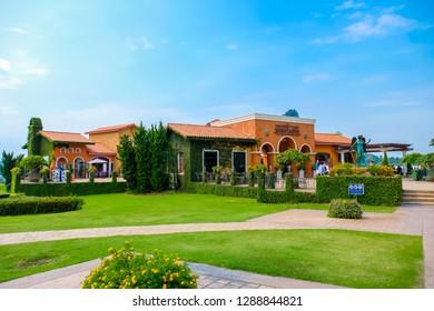 Pattaya, Thailand - January 2019 : Scenery of Silverlake Grape Farm with mountain and beautifui building at Pattaya,Thailand.