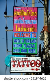 Pattaya, Thailand - January 3, 2014:  Signs and electric wires hang from poles lining Pattaya Second Road