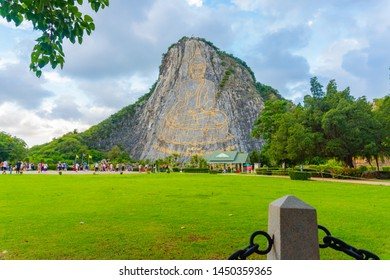 Pattaya, Thailand - July 2019 :Tourist travelling and taking photo with beautiful Buddha Mountain (Khao Chee chan) during cloudy day. Khao chee chan the largest buddha carved in the world.