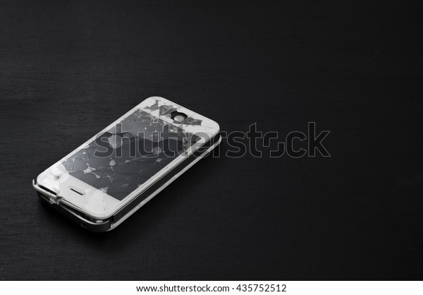PATTAYA, THAILAND - June 13: Shot of an iPhone 4S with broken retina display screen and body on chalkboard background on June 13, 2016. iPhone 4S is a smartphone developed by Apple Inc.