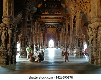 Pattaya, Thailand - March 11, 2018: Sanctuary of Truth is a religious construction and is an all-wood building filled with sculptures based on traditional Buddhist and Hindu motifs.