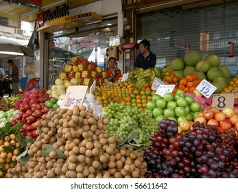 PATTAYA, THAILAND - MARCH 12: Thai woman sells fruit in a market on March 12, 2005 in Pattaya.