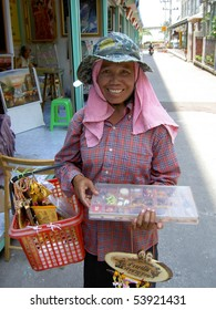 PATTAYA, THAILAND - MARCH 15: Thai woman selling religious ornaments on the roadside on March 15, 2006 in Pattaya.