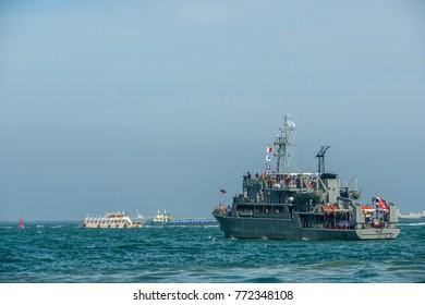 Pattaya, Thailand - November 18, 2017: Navy warship running in Pattaya bay where many tourists playing parachute with speed boat in Pattaya, Thailand