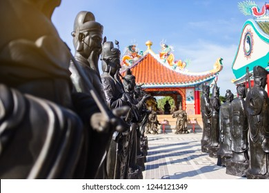 PATTAYA, THAILAND - NOVEMBER 27, 2018: View of The Viharnra Sien Temple. The Anek Kusala Sala - famous chinese temple and museum in Pattaya, Chonburi, Thailand. Black statues of shaolin wariors