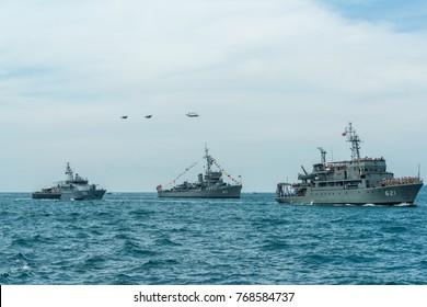 Pattaya, Thailand - November 9, 2017, Navy warships running on sea while warplanes flying above warships on the 50th anniversary ASEAN international fleet review 2017 drill in Pattaya, Thailand