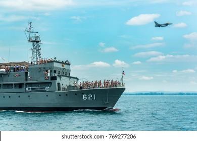 Pattaya, Thailand - November 9, 2017, Navy warships running on sea while warplane flying above warships on the 50th anniversary ASEAN international fleet review drill in Pattaya, Thailand