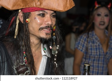 PATTAYA , THAILAND - OCTOBER 31 : Thai men celebrates Halloween on October 31 2011 in Pattaya, Thailand. Halloween has become popular in Thailand in recent years .