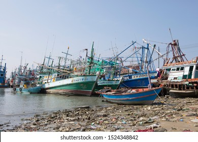 Pattaya, Thailand - September 28, 2019: Cemetery of ships in the Thailand. Destroyed wooden ships on the shore