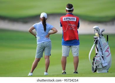 PATTAYA THAILAND-FEBRUARY 16: Ai Miyazato of Japan with caddy watches the 18hole during first round of Honda LPGA  2012 on February 16,2012 at Siam Country Club Old Course in Pattaya, Thailand