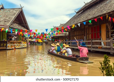 PATTAYA,THAILAND - 22 JUNE 2016 : Tourist shopping and Scenic boat ride in Pattaya Floating Market, Pattaya city famous tourist attraction of Thailand.