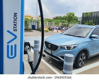 Pattaya,Thailand 23April 2021: Photos of the parked blue MG ZS EV electric car. Electric charger at the charging cradle of the Ptt gas station.