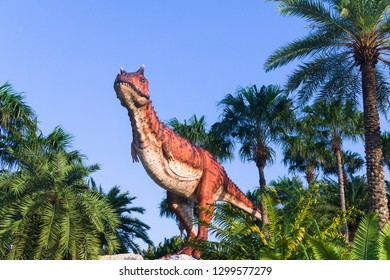 Pattaya,Thailand- April 14,2018: Carnotaurus model in a tropical garden park of Suan Nongnooch, Pattaya, Thailand. Carnotaurus is a genus of large theropod dinosaur.