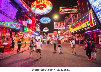 PATTAYA,THAILAND - DECEMBER 19,2015: Crowd are walking through the Walking Street in Pattaya,Thailand. Its a tourist attraction primarily for night life and entertainment.
