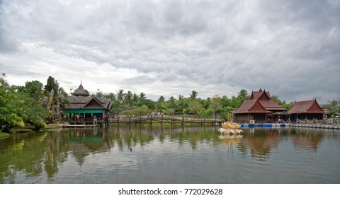 Pattaya,Thailand- November 20,2017: Lake in the park. Tourists drink tea and look at fish in the water