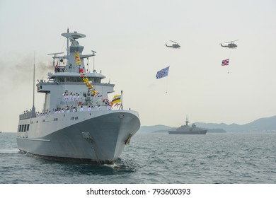 Pattaya,Thailand - November 20,2017: Navy warships running on sea while helicopter with Thai Navy flag and IFR2017 flag flying above warships on the 50th anniversary ASEAN international fleet review