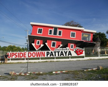 Pattaya,Thailand : September 26 2018 : Nonidentical people  are going to visit up side down house  the up side of the house will down and everything upside down  at Pattaya,Thailand.