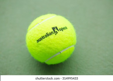 "PATTAYA,THAILAND - SEPTEMBER 9 : New wilson tennis ball with text ""austalian open"" on green hard court at September 9, 2015 in Pattaya,Thailand"
