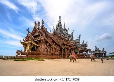 Pattaya/Thailand-JUN 6, 2019: Tourists riding elephants around the Sanctuary of Truth at Pattaya.
