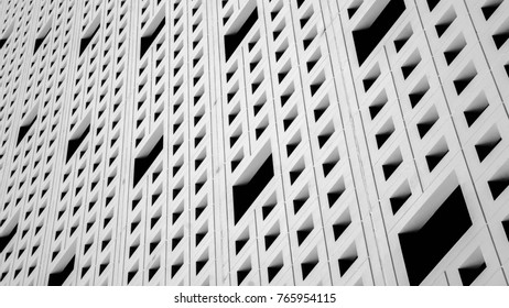 pattern of air ventilation at modern concrete building, light and shadow - monochrome