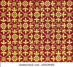 Pattern of an ancient Thai painting drawn with golden ink on the ceiling of a palace in Thailand consisting of leaves and flowers on red background.
