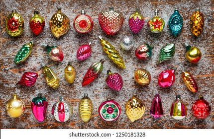 Pattern of antique Christmas toys on a Board covered with frost. Christmas and new year concept. Flat lay, top view