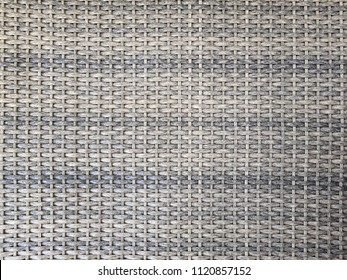 Pattern background of grey handicraft weave texture wicker surface for furniture material, rattan weave, grey chair wicker for texture background.