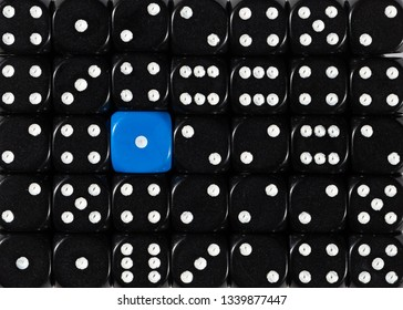 Pattern background of random ordered black dices with one blue cube