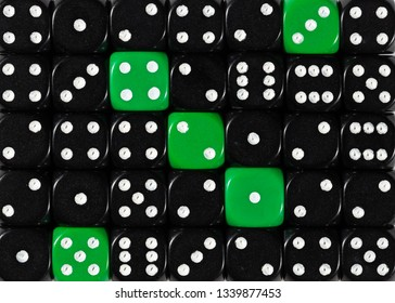 Pattern background of random ordered black dices with five green cubes