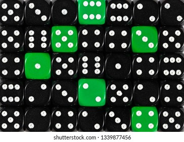 Pattern background of random ordered black dices with six green cubes
