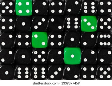Pattern background of random ordered black dices with four green cubes