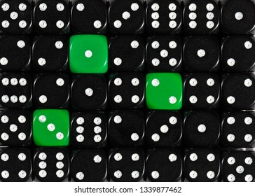 Pattern background of random ordered black dices with three green cubes