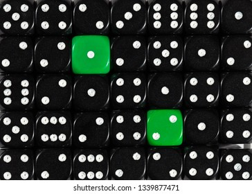 Pattern background of random ordered black dices with two green cubes