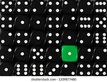 Pattern background of random ordered black dices with one green cube