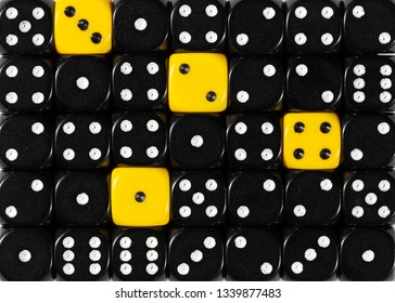 Pattern background of random ordered black dices with four yellow cubes