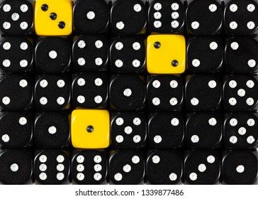 Pattern background of random ordered black dices with three yellow cubes