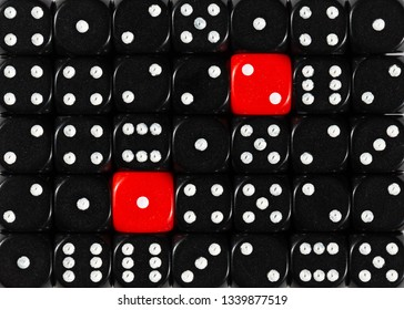 Pattern background of random ordered black dices with two red cubes