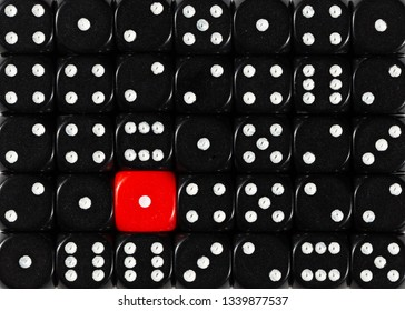 Pattern background of random ordered black dices with one red cube