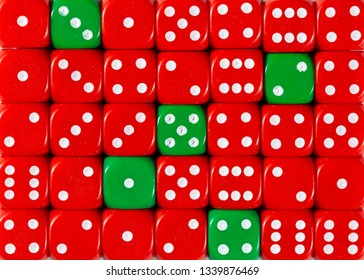 Pattern background of random ordered red dices with five green cubes
