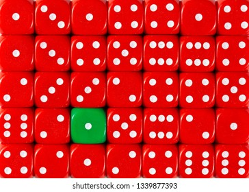 Pattern background of random ordered red dices with one green cube