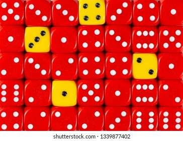 Pattern background of random ordered red dices with four yellow cubes