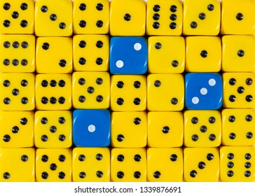 Pattern background of random ordered yellow dices with three blue cubes