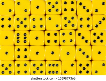 Pattern background of yellow dices, random ordered