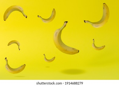 Pattern with bananas on a yellow background. Creative idea with bright sunlight. Minimum summer concept