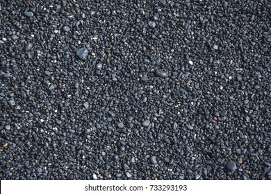 Pattern of black flickering volcanic sand texture. Iceland background